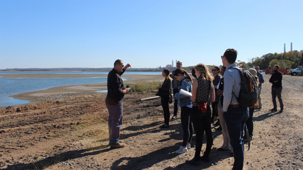Graduate students learn about municipal dredging operations in Maryland.