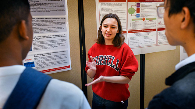 Emily La Spisa presents her poster at Cornell Energy Day.